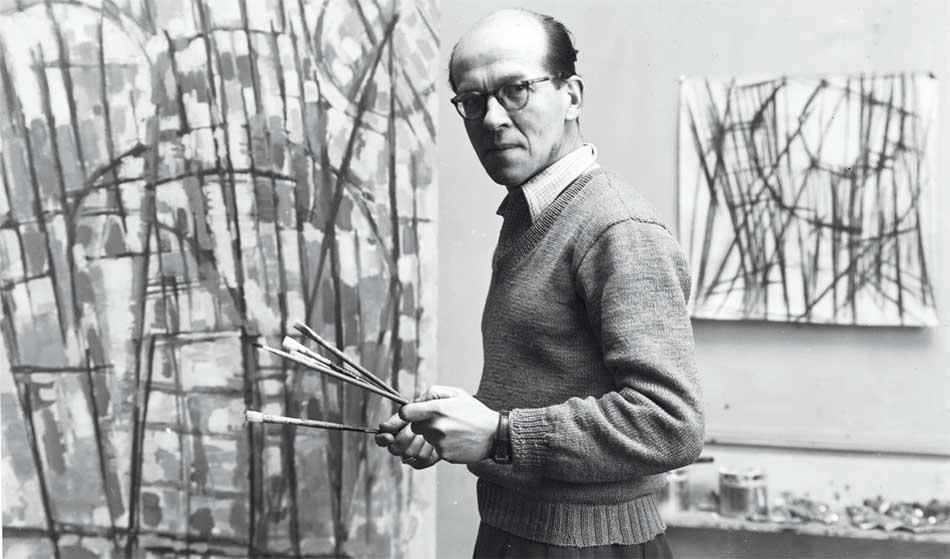 Jean Le Moal - Jean Le Moal dans son atelier rue Le Verrier à Paris, vers 1955, photographie John Craven, archives privées © Tous droits réservés