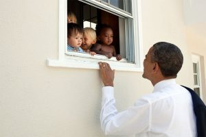 Barack Obama : No one is born hating another person because of the color of his skin or his background or his religion...